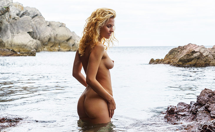 Ariel Naked on Wet Rocks
